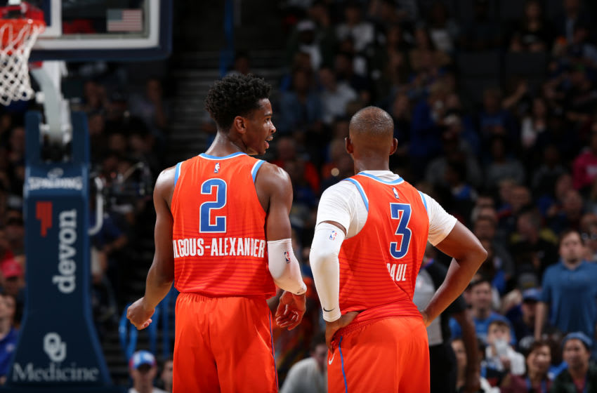 OKC Thunder: Shai Gilgeous-Alexander #2, and Chris Paul #3 talk during the game against the Golden State Warriors (Photo by Zach Beeker/NBAE via Getty Images)