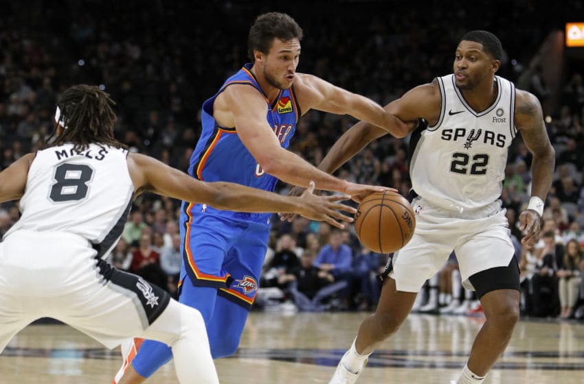 SAN ANTONIO, TX - NOVEMBER 07: Danilo Gallinari #8 of the OJC Thunder drives between Patty Mills #8 and Rudy Gay #22 (Photo by Edward A. Ornelas/Getty Images)