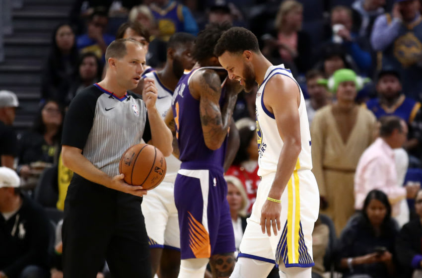 OKC Thunder - NBA Power Rankings W2: Stephen Curry #30 of the Golden State Warriors grimaces after he was injured in the second half of their game against the Phoenix Suns . (Photo by Ezra Shaw/Getty Images)