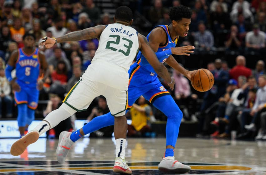 Shai Gilgeous-Alexander #2 of the OKC Thunder drives past Royce O'Neale #23 of the Utah Jazz. (Photo by Alex Goodlett/Getty Images)