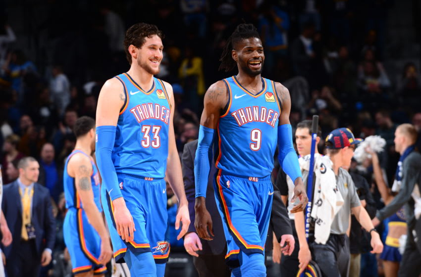 Mike Muscala #33 and Nerlens Noel #9 of the OKC Thunder smile during a game against the Denver Nuggets (Photo by Bart Young/NBAE via Getty Images)