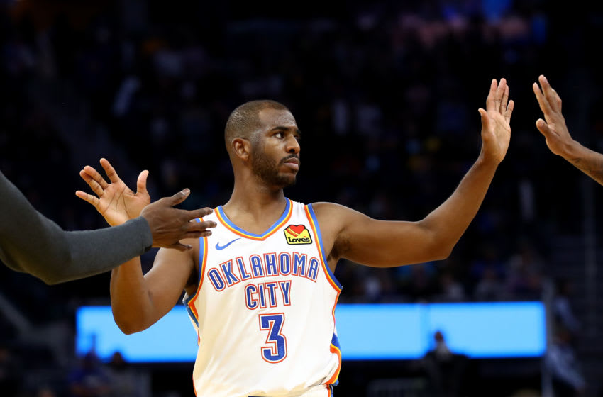 Chris Paul #3 of the OKC Thunder is congratulated by Nerlens Noel #9 and Terrance Ferguson #23 after they beat the Golden State Warriors (Photo by Ezra Shaw/Getty Images)