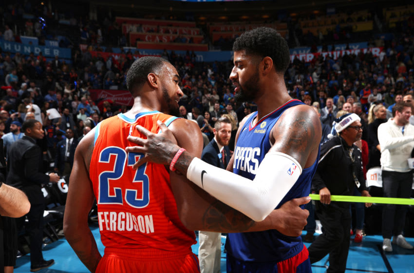 DECEMBER 22: Terrance Ferguson #23 of the OKC Thunder and Paul George #13 of the LA Clippers talk after game (Photo by Zach Beeker/NBAE via Getty Images)