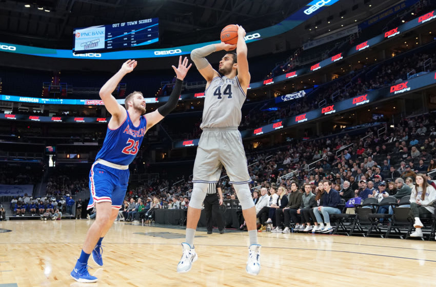 WASHINGTON, DC - DECEMBER 28: Omer Yurtseven #44 of the Georgetown Hoyas takes a jump shot over Mark Gasperini #23 of the American University Eagles in the second half during a college basketball game at the Capital One Arena on December 28, 2019 in Washington, DC. (Photo by Mitchell Layton/Getty Images)
