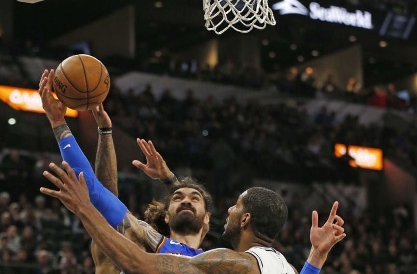 JANUARY 2: Steven Adams #12 of the OKC Thunder battles LaMarcus Aldridge #12 of the San Antonio Spurs for a rebound during second half . (Photo by Ronald Cortes/Getty Images)