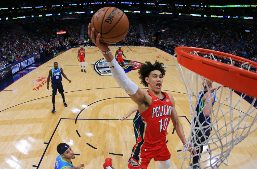 NEW ORLEANS, LOUISIANA - DECEMBER 03: Jaxson Hayes #10 of the New Orleans Pelicans dunks as Seth Curry #30 of the Dallas Mavericks defends during the second half at the Smoothie King Center on December 03, 2019 in New Orleans, Louisiana. NOTE TO USER: User expressly acknowledges and agrees that, by downloading and or using this Photograph, user is consenting to the terms and conditions of the Getty Images License Agreement. (Photo by Jonathan Bachman/Getty Images)