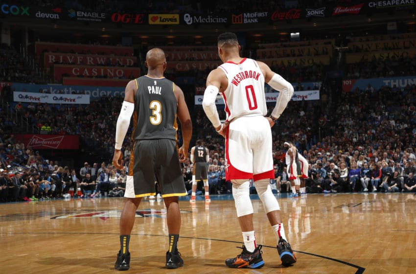 JANUARY 9: Chris Paul #3 of the OKC Thunder and Russell Westbrook #0 of the Houston Rockets looks on during the game (Photo by Jeff Haynes/NBAE via Getty Images)