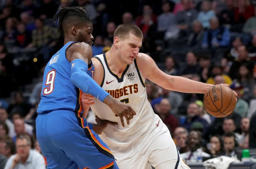 Nikola Jokic #15 of the Denver Nuggets drives against Nerlens Noel #9 of the OKC Thunder (Photo by Matthew Stockman/Getty Images)