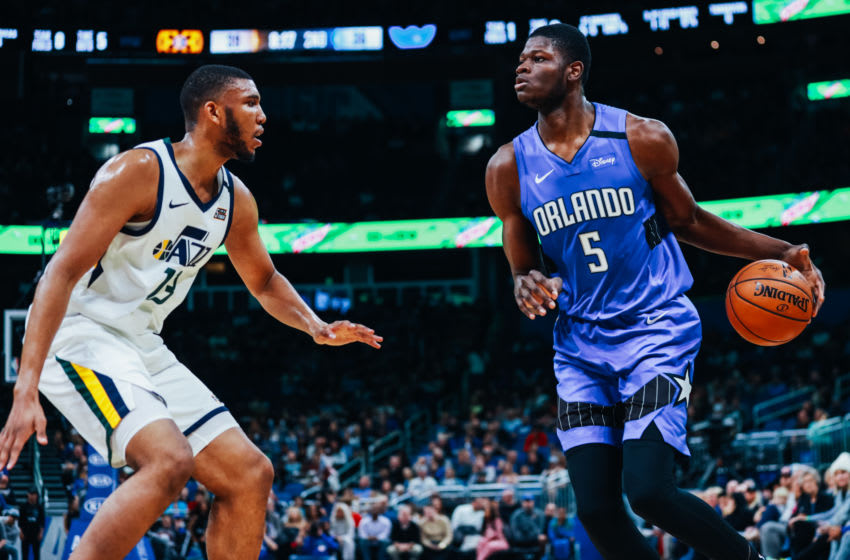 ORLANDO, FLORIDA - JANUARY 04: Mo Bamba #5 of the Orlando Magic faces off with Tony Bradley #13 of the Utah Jazz in the second quarter at Amway Center on January 04, 2020 in Orlando, Florida. NOTE TO USER: User expressly acknowledges and agrees that, by downloading and/or using this photograph, user is consenting to the terms and conditions of the Getty Images License Agreement. (Photo by Harry Aaron/Getty Images)