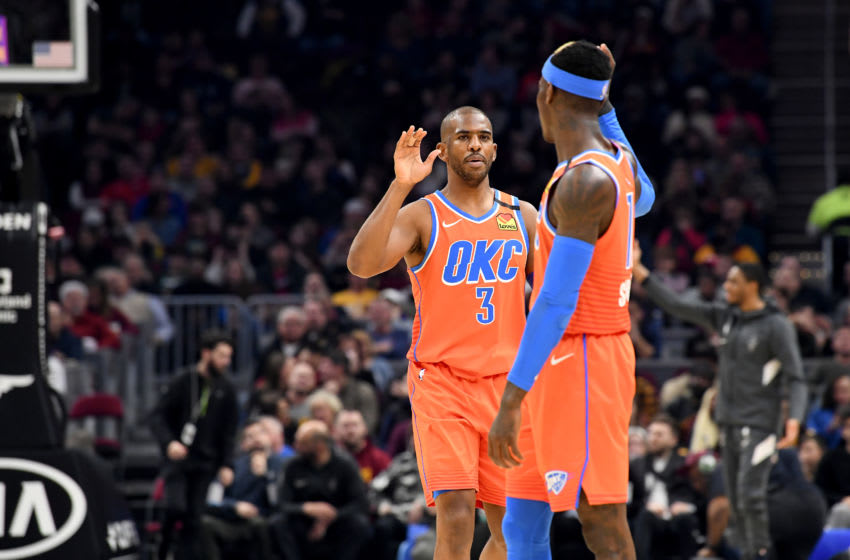 Chris Paul #3 celebrates with Dennis Schroder #17 of the OKC Thunder after the two connected for a score during the first half against the Cleveland Cavaliers (Photo by Jason Miller/Getty Images)