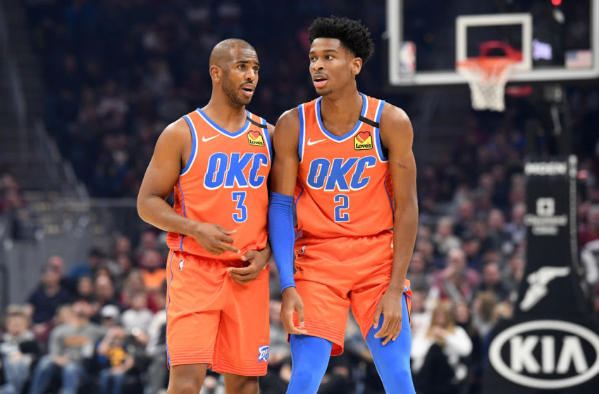 Chris Paul #3 talks with Shai Gilgeous-Alexander #2 of the OKC Thunder. (Photo by Jason Miller/Getty Images)