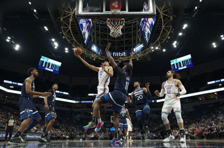 January 13: OKC Thunder forward Darius Bazley (7) shot while Minnesota Timberwolves center Naz Reid (11) defended in the first half. (Photo by Jeff Wheeler/Star Tribune via Getty Images)