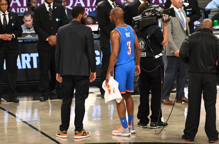 Kyrie Irving #11 of the Brooklyn Nets talks with Chris Paul #3 of the OKC Thunder. (Photo by Matteo Marchi/Getty Images)
