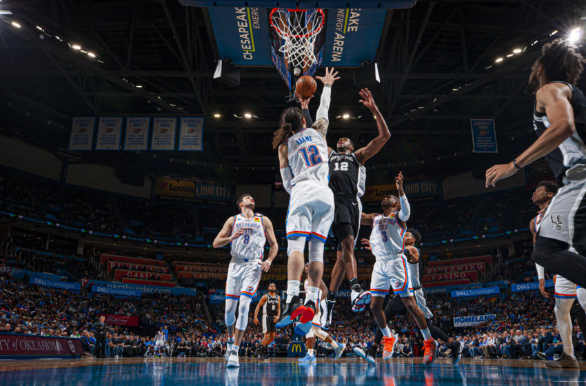 FEBRUARY 11: LaMarcus Aldridge #12 of the San Antonio Spurs drives to the basket during the game against the OKC Thunder (Photo by Zach Beeker/NBAE via Getty Images)