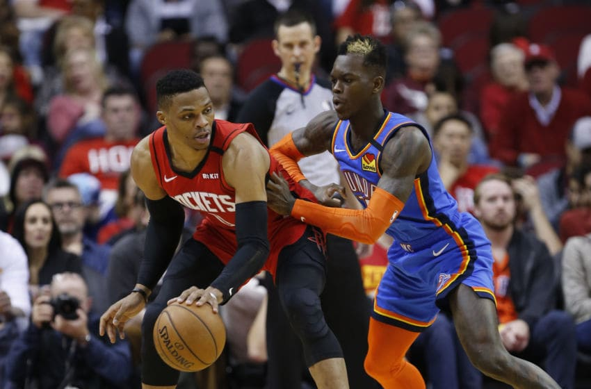 JANUARY 20: Russell Westbrook #0 of the Houston Rockets is guarded by Dennis Schroder #17 of the OKC Thunder during the fourth quarter (Photo by Bob Levey/Getty Images)