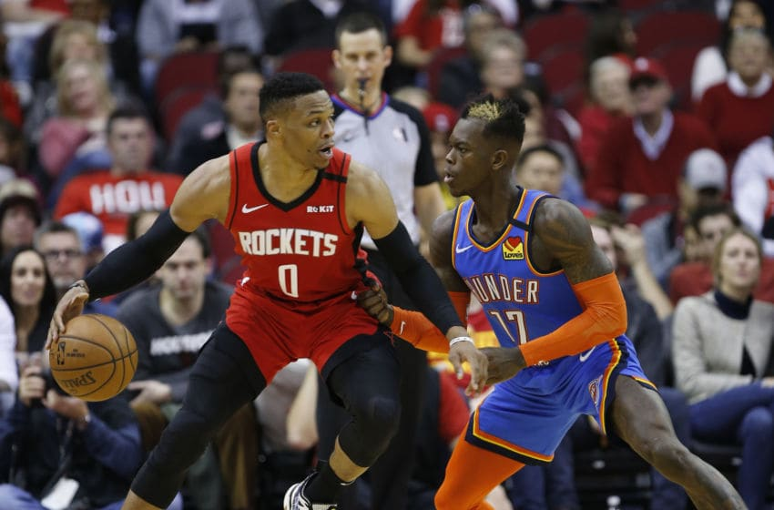 Russell Westbrook #0 of the Houston Rockets is guarded by Dennis Schroder #17 of the OKC Thunder. (Photo by Bob Levey/Getty Images)