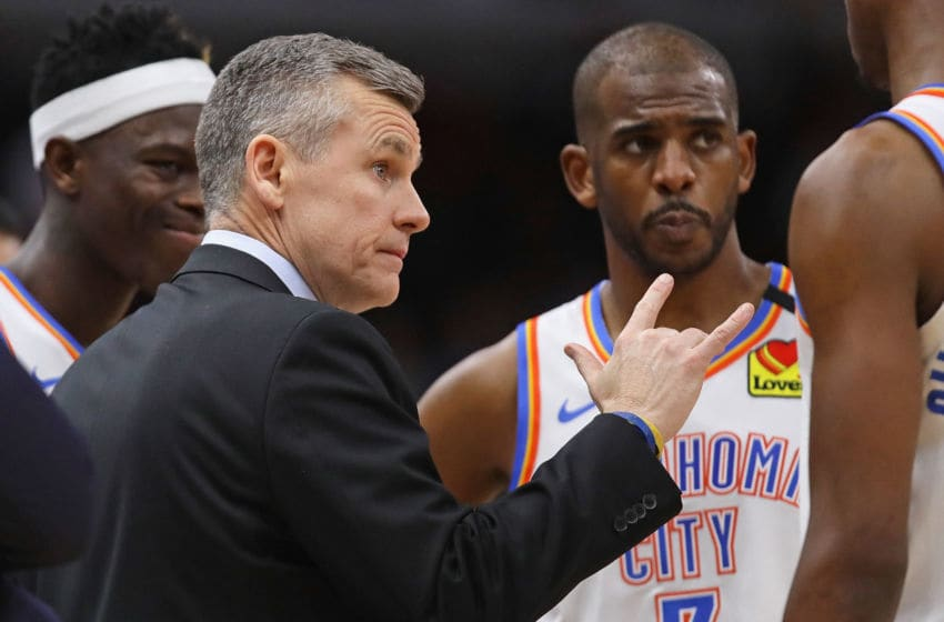 Head coach Billy Donovan of the OKC Thunder talks to his players, including Luguentz Dort #5 (L) and Chris Paul #3 . (Photo by Jonathan Daniel/Getty Images)