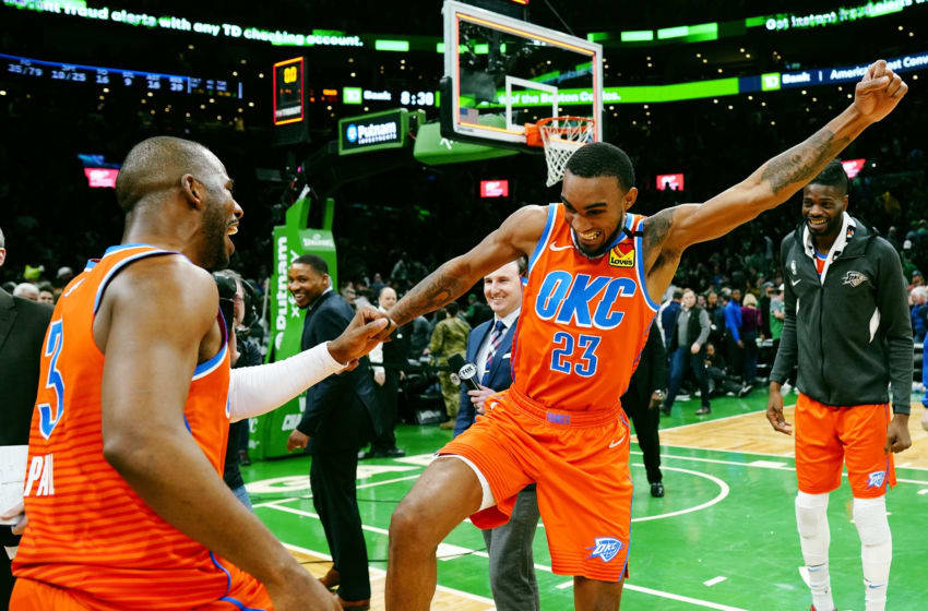 Terrance Ferguson #23 of the OKC Thunder and Chris Paul #3 celebrate after the victory over the Boston Celtics. (Photo by Omar Rawlings/Getty Images)