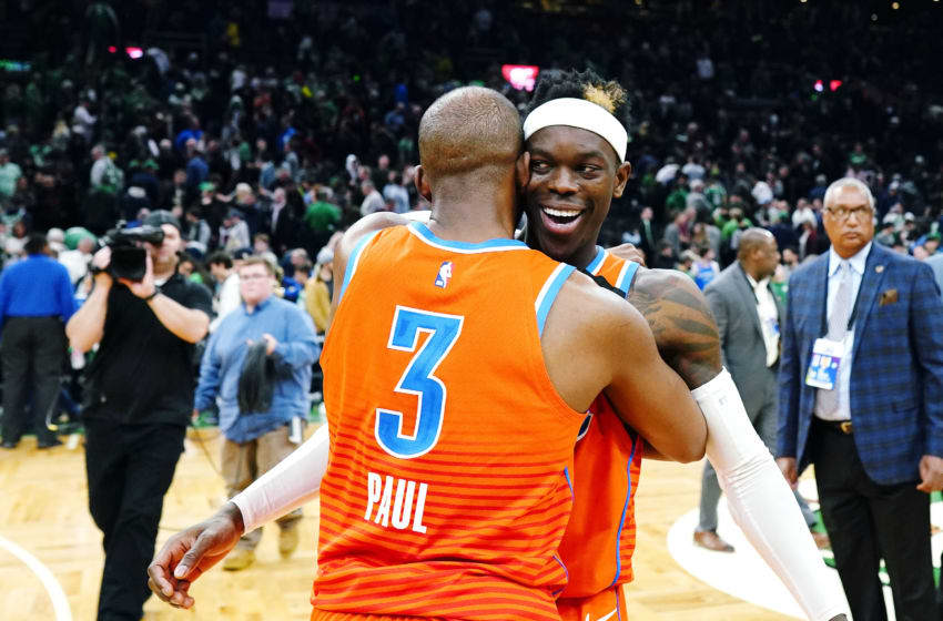 Chris Paul #3 of the OKC Thunder embraces Dennis Schroder #17 after the victory over the Boston Celtics (Photo by Omar Rawlings/Getty Images)