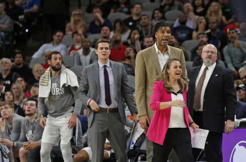 OKC Thunder head coach search: Assistant coach of the San Antonio Spurs Becky Hammond and Tim Duncan react to a play . (Photo by Ronald Cortes/Getty Images)