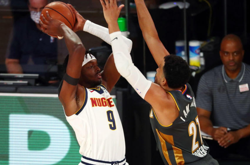 AUGUST 03: Jerami Grant #9 of the Denver Nuggets handles the ball against Andre Roberson #21 of the OKC Thunder in the first half. (Photo by Kim Klement-Pool/Getty Images)