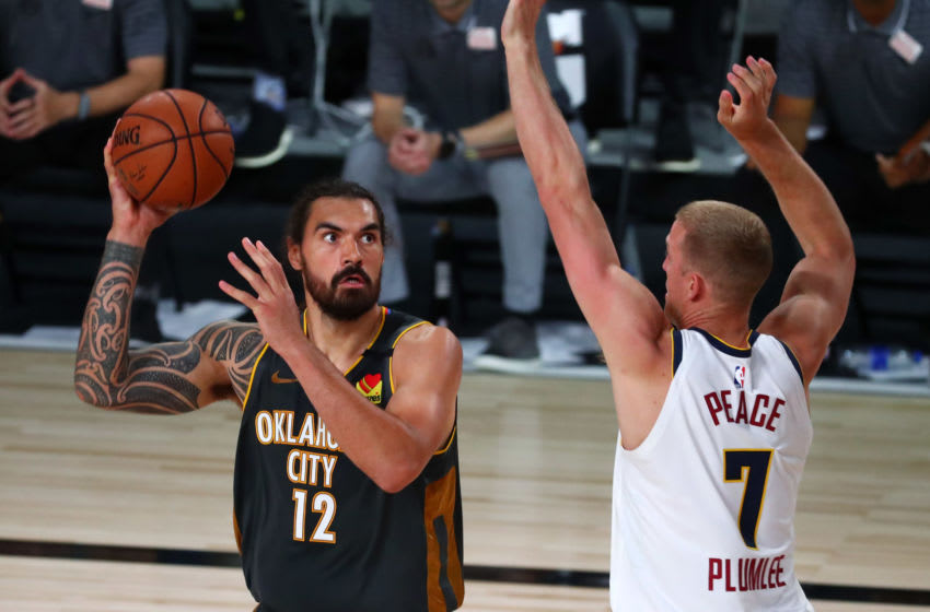 Steven Adams #12 of the OKC Thunder shoots the ball against Mason Plumlee #7 of the Denver Nuggets. (Photo by Kim Klement - Pool/Getty Images)