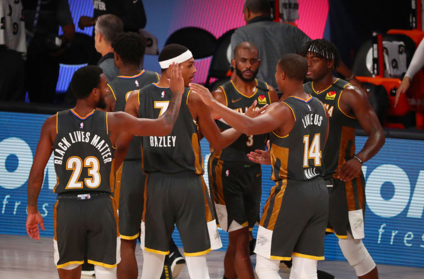AUGUST 09: Terrance Ferguson #23, Darius Bazley #7, Chris Paul #3, Devon Hall #14, and Luguentz Dort #5 of the OKC Thunder celebrate after defeating the Washington Wizards (Photo by Kim Klement - Pool/Getty Images)