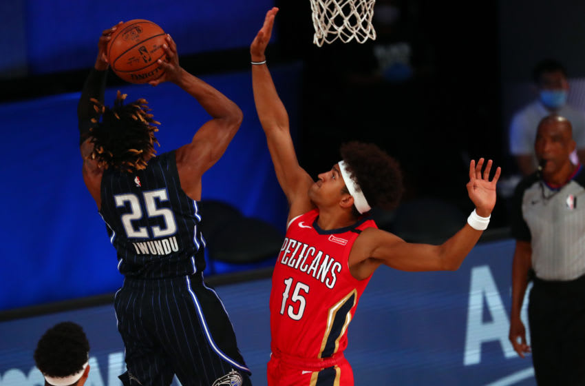OKC Thunder offseason: Wes Iwundu #25 shoots against Frank Jackson #15 of the Pelicans. (Photo by Kim Klement-Pool/Getty Images)