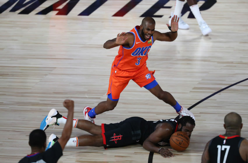 AUGUST 18: Chris Paul #3 of the OKC Thunder reacts after fouling James Harden #13 of the Houston Rockets . (Photo by Kim Klement-Pool/Getty Images)