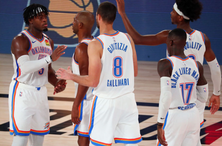AUGUST 24: Luguentz Dort #5 celebrates with Chris Paul #3, Danilo Gallinari #8, Dennis Schroder #17, and Shai Gilgeous-Alexander #2 of the OKC Thunder celebrate after defeating the Houston Rockets in game four. (Photo by Kim Klement-Pool/Getty Images)