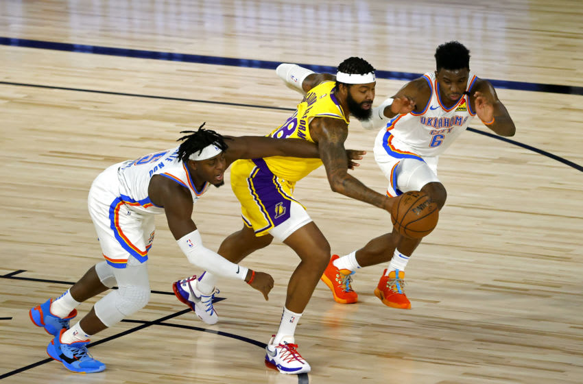 AUGUST 05: Markieff Morris #88 of the Los Angeles Lakers battles for the ball with Luguentz Dort #5 and Hamidou Diallo #6 of the OKC Thunder during the second quarter. (Photo by Kevin C. Cox/Getty Images)