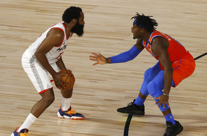 AUGUST 22: James Harden #13 of the Houston Rockets drives against Luguentz Dort #5 of the OKC Thunder during the second quarter in Game Three . (Photo by Mike Ehrmann/Getty Images)