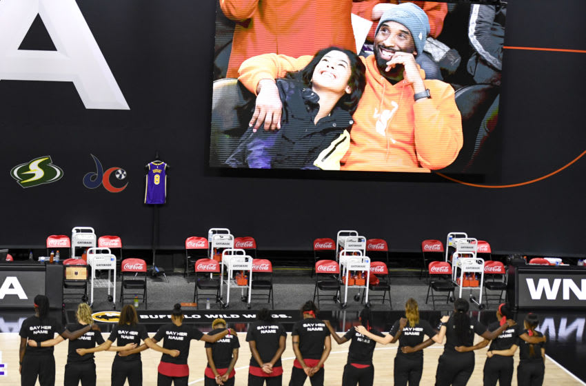 OKC Thunder Atlanta Dream players and staff stand together during a 24-second tribute to Kobe Bryant. (Photo by Douglas P. DeFelice/Getty Images)