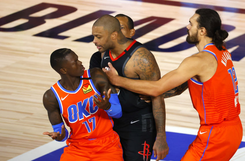 AUGUST 29: P.J. Tucker #17 of the Houston Rockets is held back by Steven Adams #12 of the OKC Thunder and referee Eric Lewis #42 after head butting Dennis Schroder #17 of the OKC Thunder during the third quarter in Game Five. (Photo by Kevin C. Cox/Getty Images)