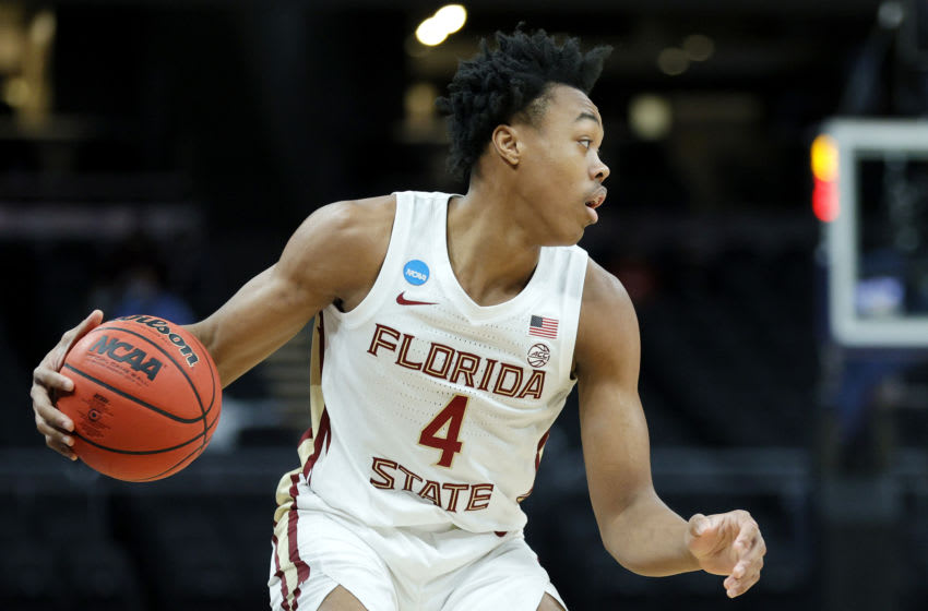 INDIANAPOLIS, INDIANA - MARCH 20: Scottie Barnes #4 of the Florida State Seminoles handles the ball during the first half against the UNC-Greensboro Spartans in the first round game of the 2021 NCAA Men's Basketball Tournament at Bankers Life Fieldhouse on March 20, 2021 in Indianapolis, Indiana. (Photo by Sarah Stier/Getty Images)
