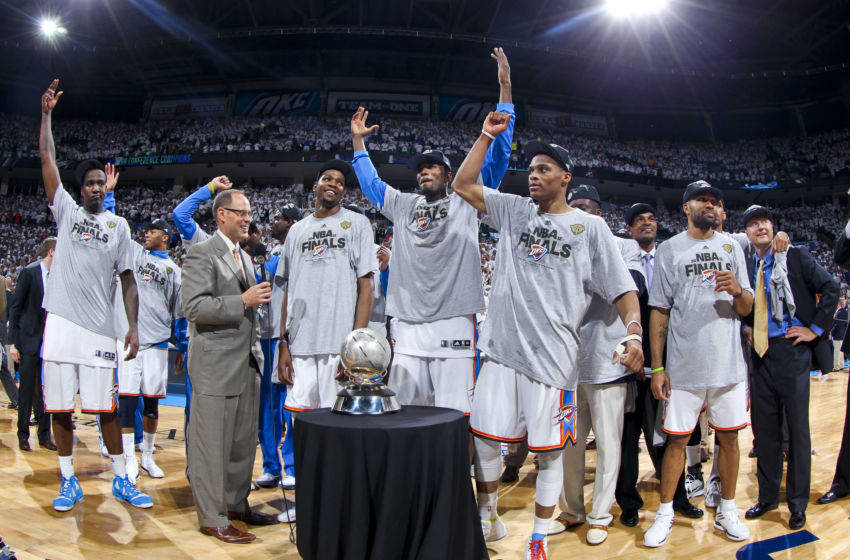 OKLAHOMA CITY, OK - JUNE 6: Oklahoma City Thunder players, from left, Kendrick Perkins #5, Kevin Durant #35, Serge Ibaka #9 and Russell Westbrook #0 celebrate with the Western Conference Finals Champions trophy following their team's victory against the San Antonio Spurs in Game Six of the Western Conference Finals during the 2012 NBA Playoffs on June 6, 2012 at the Chesapeake Energy Arena in Oklahoma City, Oklahoma. NOTE TO USER: User expressly acknowledges and agrees that, by downloading and or using this Photograph, user is consenting to the terms and conditions of the Getty Images License Agreement. Mandatory Copyright Notice: Copyright 2012 NBAE (Photo by Layne Murdoch/NBAE via Getty Images)