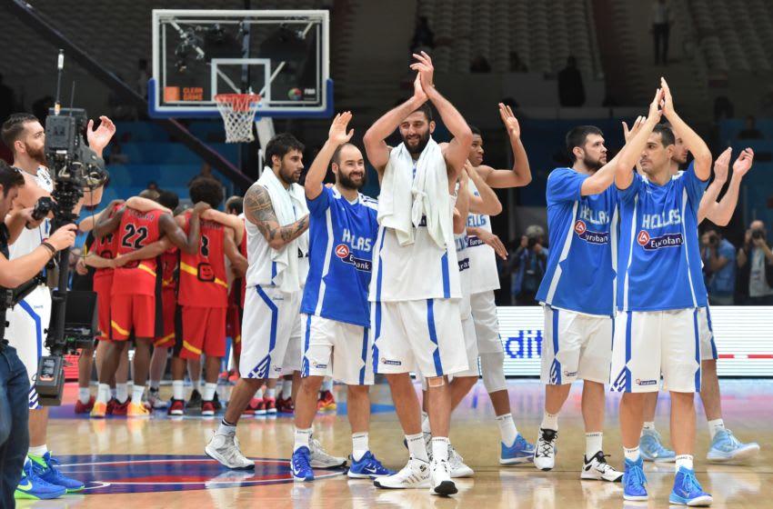 OKC Thunder rookie Aleksej Pokusevski, Greece teammates react after Greece defeated Belgium (Photo credit should read PHILIPPE HUGUEN/AFP via Getty Images)
