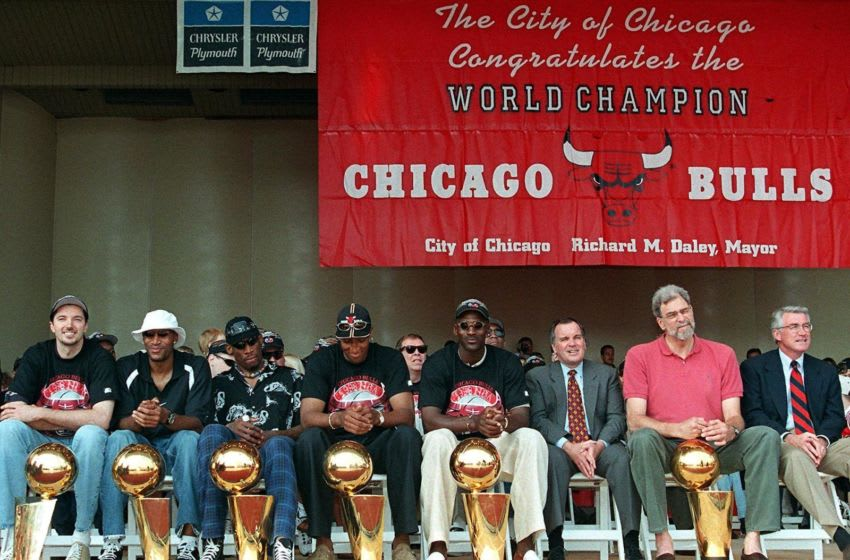OKC Thunder From left, Toni Kukoc, Ron Harper, Dennis Rodman, Scottie Pippen, and Michael Jordan and Phil Jackson as they celebrate the Bulls third straight title and sixth in eight years. (Photo credit should read PETER PAWINSKI/AFP via Getty Images)
