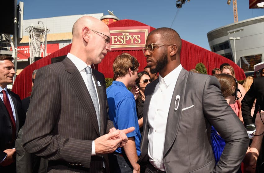 Commissioner of the NBA Adam Silver (L) and NBA player Chris Paul of OKC Thunder (Photo by Kevin Mazur/Getty Images)