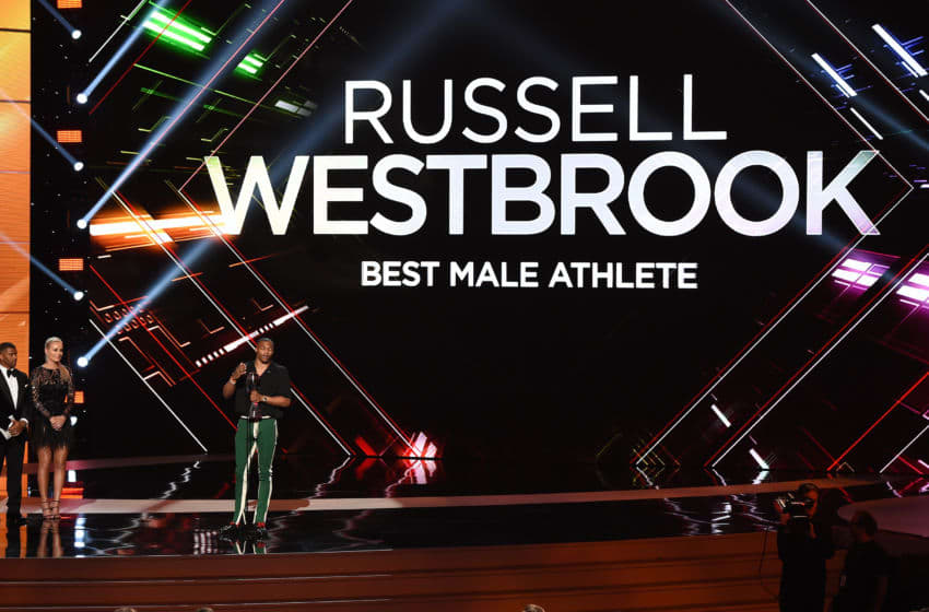 LOS ANGELES, CA - JULY 12: NBA player Russell Westbrook (R) accepts the Best Male Athlete award from NFL player Russell Wilson and Olympic skier Lindsey Vonn onstage at The 2017 ESPYS at Microsoft Theater on July 12, 2017 in Los Angeles, California. (Photo by Kevin Winter/Getty Images)
