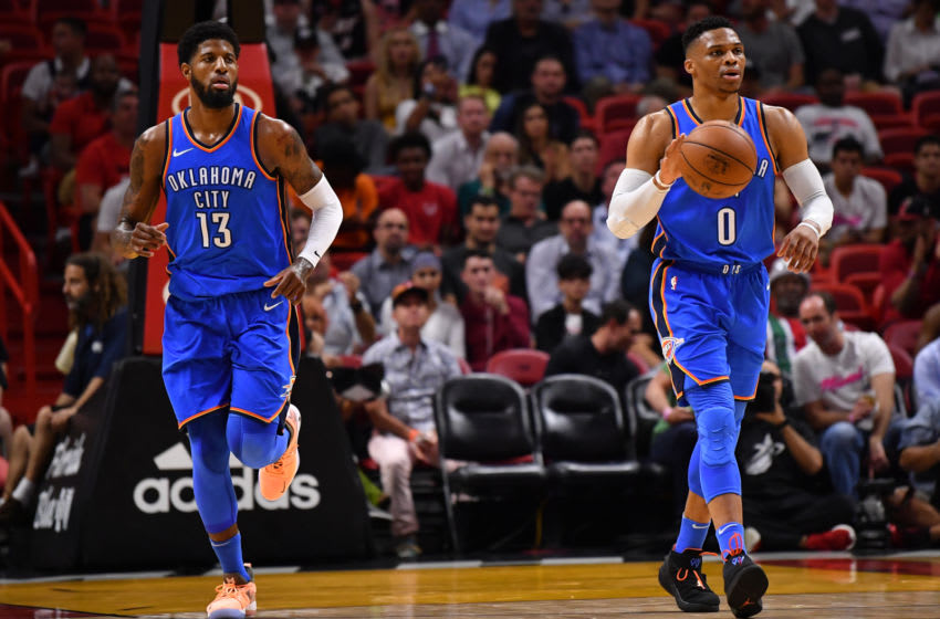 MIAMI, FL - APRIL 09: Russell Westbrook #0 moves the ball up the court with Paul George #13 of the Oklahoma City Thunder during the game against the Miami Heat at American Airlines Arena on April 9, 2018 in Miami, Florida. NOTE TO USER: User expressly acknowledges and agrees that, by downloading and or using this photograph, User is consenting to the terms and conditions of the Getty Images License Agreement. (Photo by B51/Mark Brown/Getty Images)