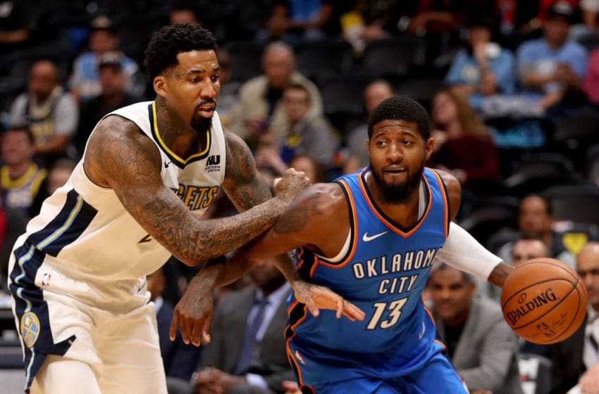 DENVER, CO - OCTOBER 10: Paul George #13 of the OKC Thunder drives to the basket against Wilson Chandler #21 of the Denver Nuggets at the Pepsi Center on October 10, 2017 in Denver, Colorado. (Photo by Matthew Stockman/Getty Images)