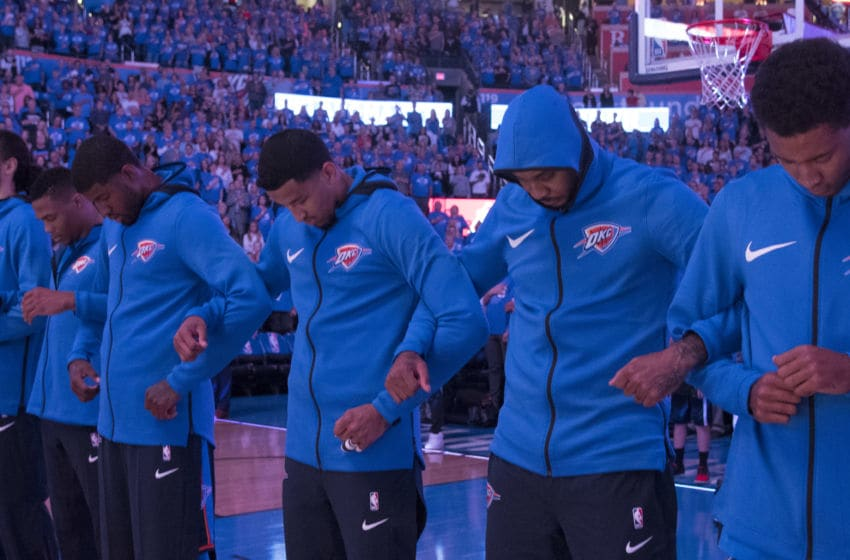 OKLAHOMA CITY, OK - OCTOBER 19: OKC Thunder players link arms during the national anthem before a NBA game against the New York Knicks at the Chesapeake Energy Arena on October 19, 2017 in Oklahoma City, Oklahoma. (Photo by J Pat Carter/Getty Images)