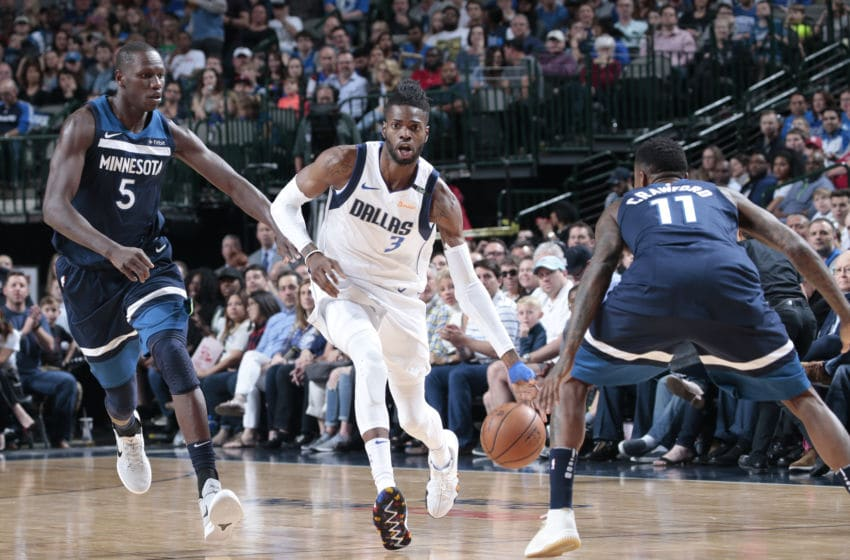 DALLAS, TX - MARCH 30: Nerlens Noel #3 of the Dallas Mavericks handles the ball against the Minnesota Timberwolves on March 30, 2018 at the American Airlines Center in Dallas, Texas. NOTE TO USER: User expressly acknowledges and agrees that, by downloading and or using this photograph, User is consenting to the terms and conditions of the Getty Images License Agreement. Mandatory Copyright Notice: Copyright 2018 NBAE (Photo by Glenn James/NBAE via Getty Images)