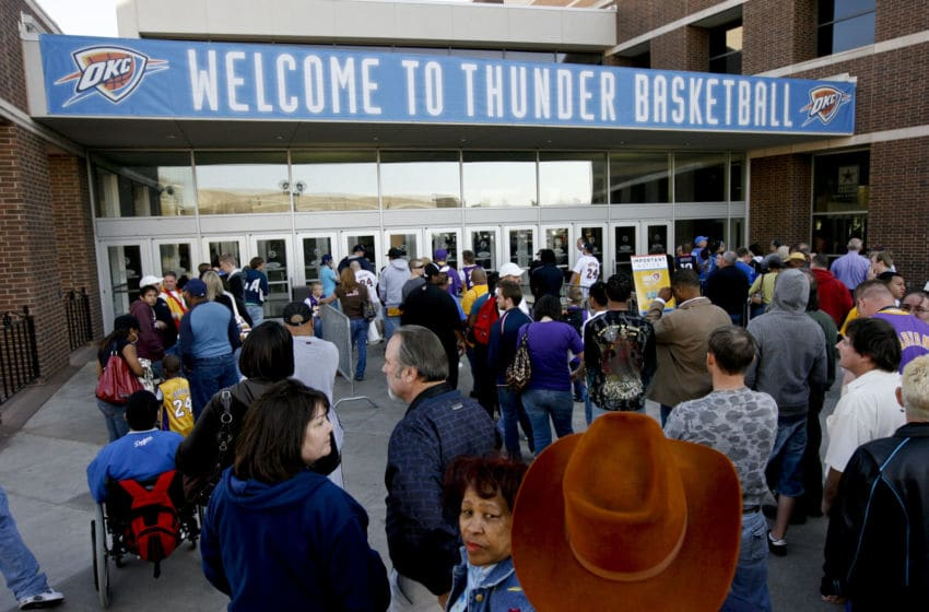 UNITED STATES - MARCH 24: Fans wait to enter the Ford Center for a National Basketball Association (NBA) game between the Los Angeles Lakers and the Oklahoma City Thunder in Oklahoma City, Oklahoma, U.S., on Tuesday, March 24, 2009. Nearly three decades after an energy bust that forced 122 banks to close statewide, Oklahoma City is in the fifth year of an economic expansion that's produce the lowest jobless rate for a major metro U.S. area. Oklahoma City demonstrated it could support a NBA team, encouraging the Seattle Supersonics to move permanently and become the Thunder, which now draw crowds as large as the Boston Celtics. (Photo by J.P. Wilson/Bloomberg via Getty Images)