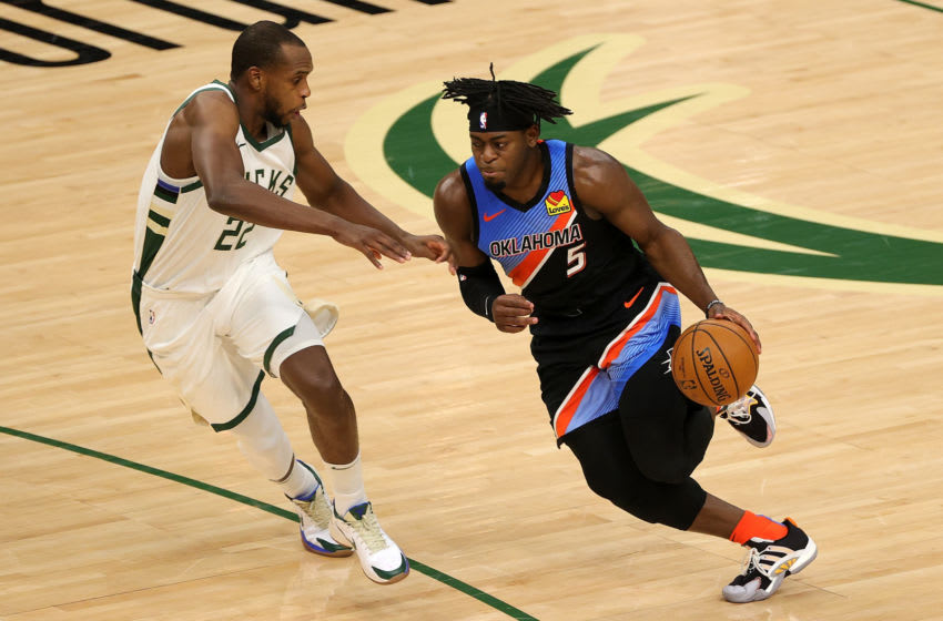 Lu Dort #5 of the OKC Thunder is defended by Khris Middleton #22 of the Milwaukee Bucks.(Photo by Stacy Revere/Getty Images)