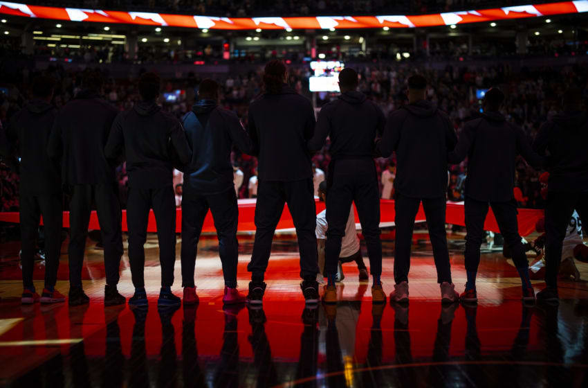 OKC Thunder players stand during the National Anthem. (Photo by Zach Beeker/NBAE via Getty Images)