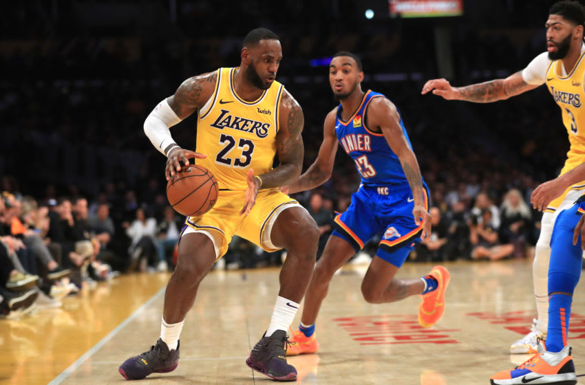 NOVEMBER 19: LeBron James #23 of the Los Angeles Lakers dribbles past the defense of Terrance Ferguson #23 of the OKC Thunder d (Photo by Sean M. Haffey/Getty Images)