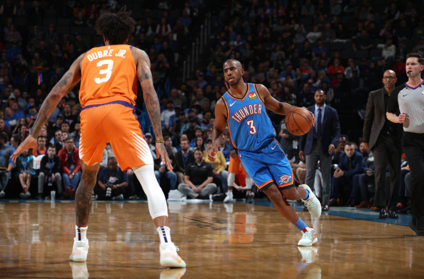 OKLAHOMA CITY, OK- DECEMBER 20: Chris Paul #3 of the Oklahoma City Thunder drives to the basket against the Phoenix Suns on December 20, 2019 at Chesapeake Energy Arena in Oklahoma City, Oklahoma. NOTE TO USER: User expressly acknowledges and agrees that, by downloading and or using this photograph, User is consenting to the terms and conditions of the Getty Images License Agreement. Mandatory Copyright Notice: Copyright 2019 NBAE (Photo by Zach Beeker/NBAE via Getty Images)