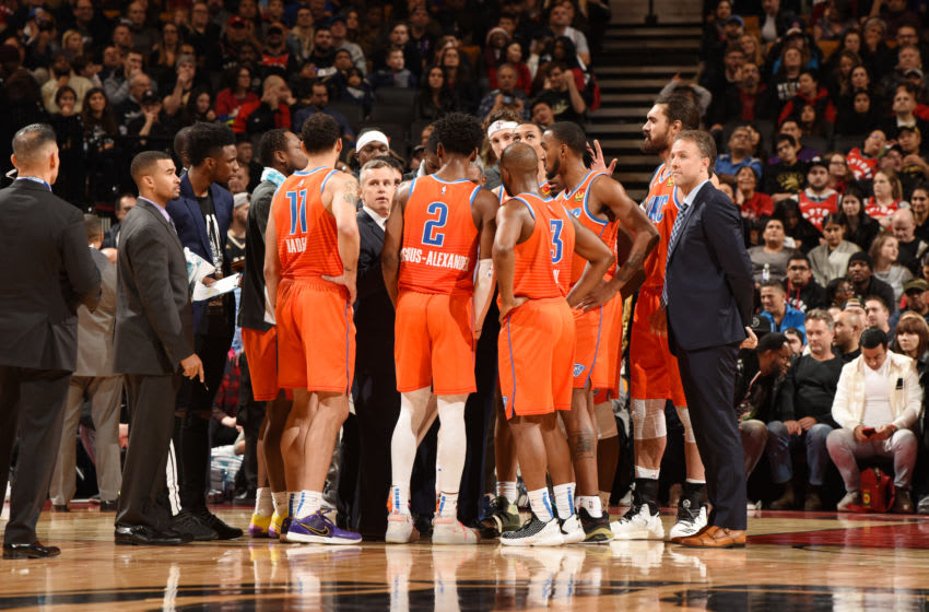 OKC Thunder huddle up during the game (Photo by Ron Turenne/NBAE via Getty Images)